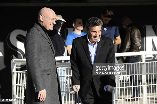 President of the French Rugby Federation Bernard Laporte speaks with Montpellier's French president Mohed Altrad prior to the the French Top 14 rugby...