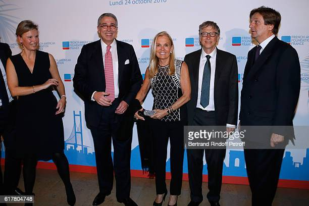 President of the 'FrenchAmerican Foundation France' and CEO of Vivendi Arnaud de Puyfontaine with his wife Benedicte Ambassador of USA in France Jane...