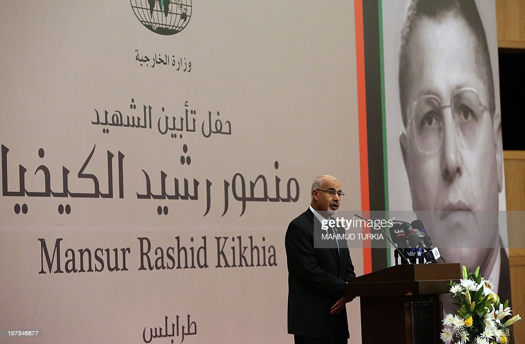 President of the General National Congress of Libya, Mohammed Megaryef, speaks during a memorial service for leading Libyan dissident, Mansour Rashid al-Kikhia (portrait), in Tripoli on December 2, 2012. Kikhia, who disappeared 19 years ago under the Kadhafi regime, is to be buried on December 3, weeks after his body was found in an intelligence services morgue, his brother said. AFP PHOTO / MAHMUD TURKIA