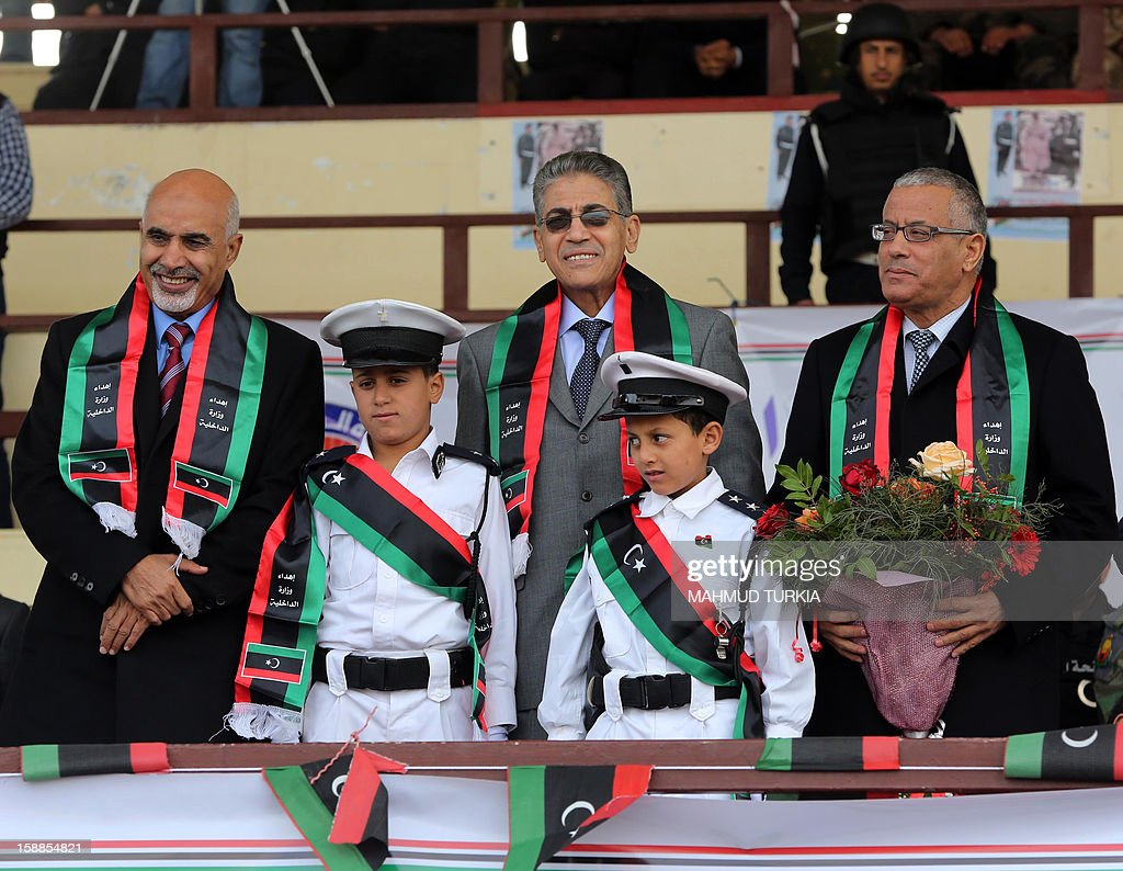 President of the General National Congress of Libya Mohammed Megaryef (L), Interior Minister Ashour Shuail (C) and Prime Minister Ali Zaidan attend a police graduation ceremony at a police academy in the district of Salaheddin in Tripoli on January 1, 2013.