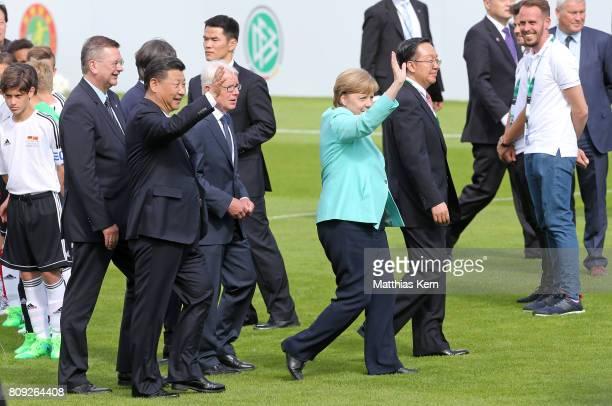 President of the German Football Association Reinhard Grindel Chinese President Xi Jinping President of the German Football League Reinhard Rauball...