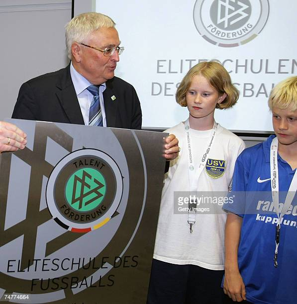 president of the German Football Association Theo Zwanziger 11 year old sports students and soccer players Johanna Klaucke and Martino Schulz pose...