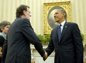 President of the Government of the Kingdom of Spain Mariano Rajoy Brey shakes hands with US President Barack Obama in the Oval Office of the White...