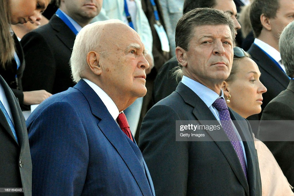 President of the Hellenic Republic, Mr <a gi-track='captionPersonalityLinkClicked' href=/galleries/search?phrase=Karolos+Papoulias&family=editorial&specificpeople=743016 ng-click='$event.stopPropagation()'>Karolos Papoulias</a> and Deputy Prime Minister of the Russian Federation, Mr Dmitry Kozak attend the Olympic Torch Handover Ceremony on October 05, 2013 in Athens, Greece.