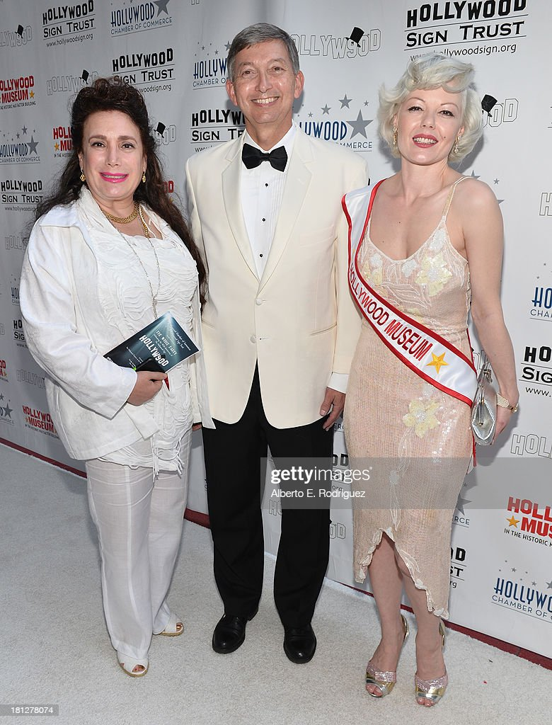 President of The Hollywood Museum, Donelle Dadigan, President of The Hollywood Chamber of Commerce, Leron Gubler and a Marilyn Monroe look alike attend The Hollywood Chamber of Commerce & The Hollywood Sign Trust's 90th Celebration of the Hollywood Sign at Drai's Hollywood on September 19, 2013 in Hollywood, California.