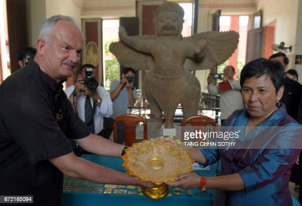 President of the Hungarian Southeat Asian Research Institute Dr Zelnik Istvan presents an art object to Minister of Culture and Fine Arts Phoeung...