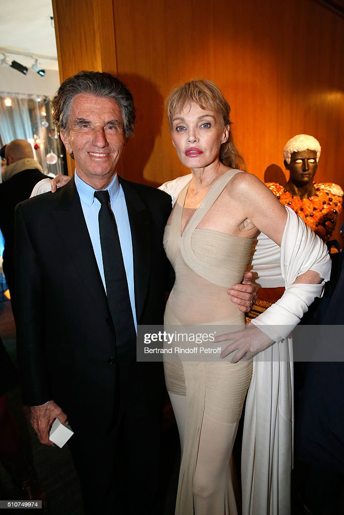 President of the 'Institut du Monde Arabe' Jack Lang and Arielle Dombasle attend Arielle Dombasle presents her Perfume 'Le secret d'Arielle' at Galerie Pierre Passebon on February 16, 2016 in Paris, France.