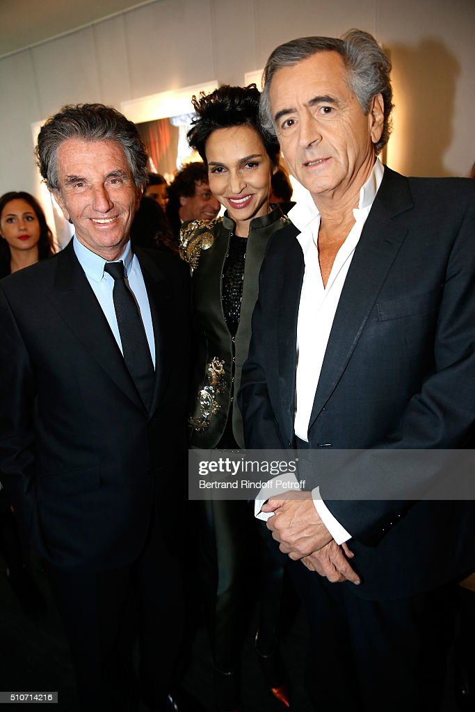 President of the 'Institut du Monde Arabe' <a gi-track='captionPersonalityLinkClicked' href=/galleries/search?phrase=Jack+Lang&family=editorial&specificpeople=220296 ng-click='$event.stopPropagation()'>Jack Lang</a>, <a gi-track='captionPersonalityLinkClicked' href=/galleries/search?phrase=Farida+Khelfa&family=editorial&specificpeople=4866090 ng-click='$event.stopPropagation()'>Farida Khelfa</a> and Bernard-Henri Levy attend Arielle Dombasle presents her Perfume 'Le secret d'Arielle' at Galerie Pierre Passebon on February 16, 2016 in Paris, France.