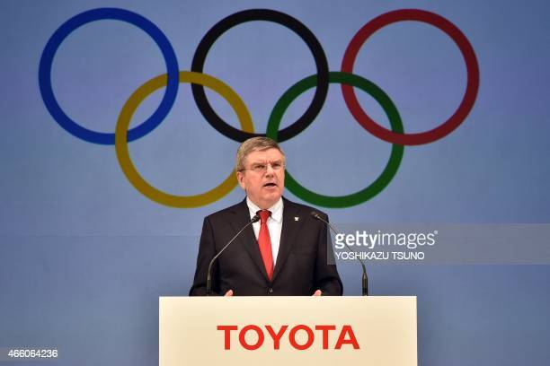 President of the International Olympic Committee Thomas Bach speaks as IOC and Japanese auto giant Toyota Motor exchange an agreement of Toyota's...