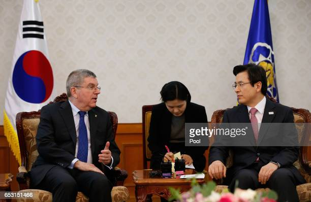 President of the International Olympic Committee Thomas Bach talks with South Korea's Prime Minister and acting President Hwang Kyoahn on March 14...
