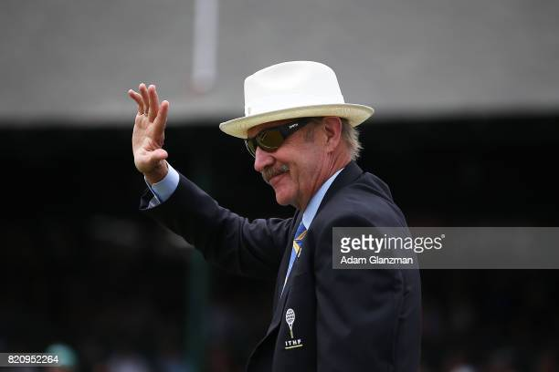 President of the International Tennis Hall of Fame Stan Smith waves to the crowd during the Tennis Hall of Fame induction ceremonies at the...