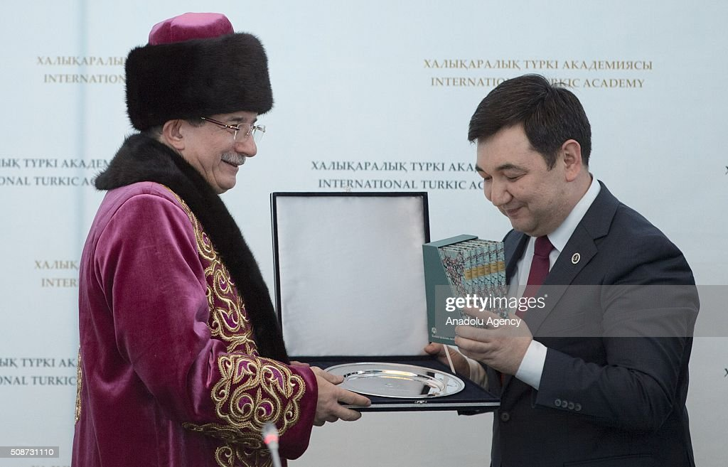 President of the International Turkish Academy Darkhan Kydyrali (R) gives books as a gift to Prime Minister of Turkey Ahmet Davutoglu (L) during the conference organized by Turkish academy at Peace and Reconciliation Palace in Astana, Kazakhstan on February 6, 2016.