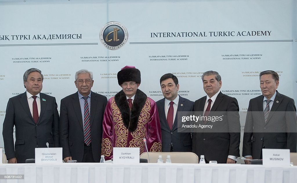 President of the International Turkish Academy Darkhan Kydyrali (R-3), Prime Minister of Turkey Ahmet Davutoglu (L-3) and other representatives pose for a photograph during the conference organized by Turkish academy at Peace and Reconciliation Palace in Astana, Kazakhstan on February 6, 2016.