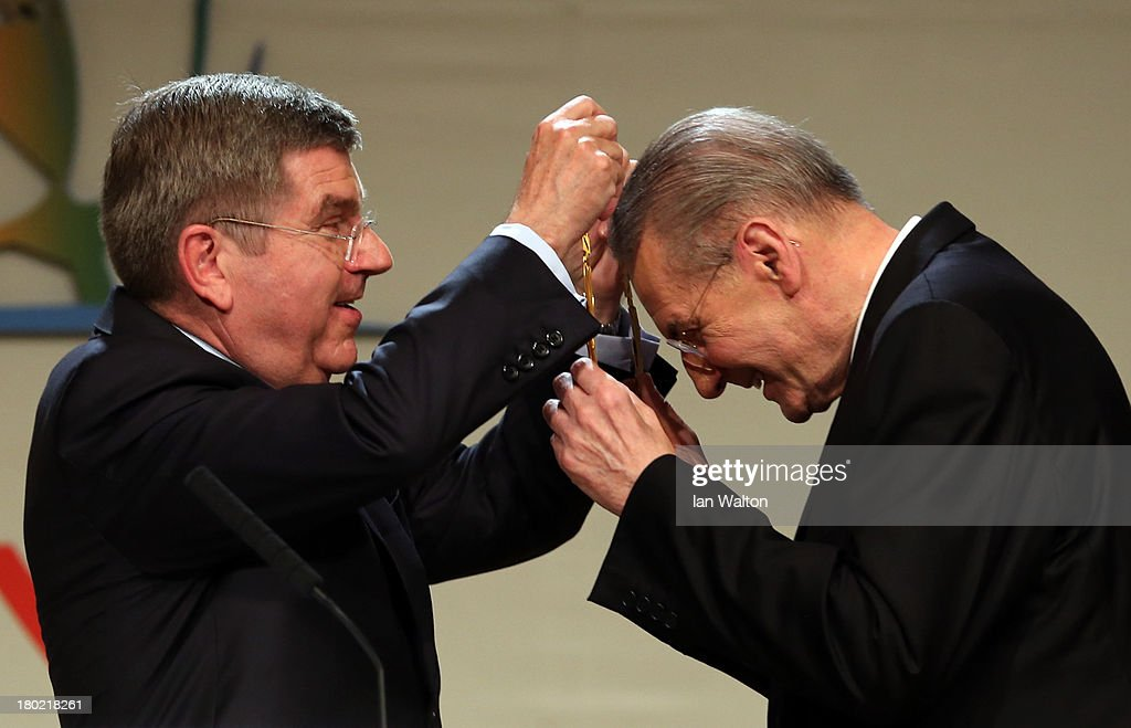 President of the IOC <a gi-track='captionPersonalityLinkClicked' href=/galleries/search?phrase=Jacques+Rogge&family=editorial&specificpeople=206143 ng-click='$event.stopPropagation()'>Jacques Rogge</a> receives the Olympic Order from newly announced ninth IOC President <a gi-track='captionPersonalityLinkClicked' href=/galleries/search?phrase=Thomas+Bach&family=editorial&specificpeople=610149 ng-click='$event.stopPropagation()'>Thomas Bach</a> during the 125th IOC Session - IOC Presidential Election at the Hilton Hotel on on September 10, 2013 in Buenos Aires, Argentina.