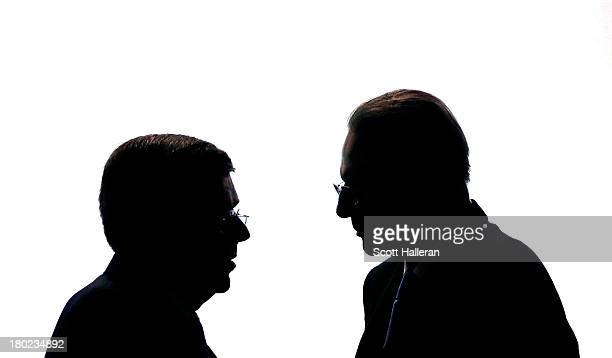 President of the IOC Jacques Rogge talks to the newly appointed ninth IOC President Thomas Bach as he makes his Closing Speech during the 125th IOC...