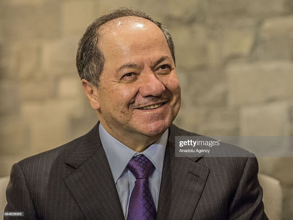 President of the Iraqi Kurdistan Masoud Barzani smiles during the meeting with Turkey's Foreign Minister Ahmet Davutoglu (not seen) in World Economic Forum, Davos, Switzerland, on January 23, 2014.