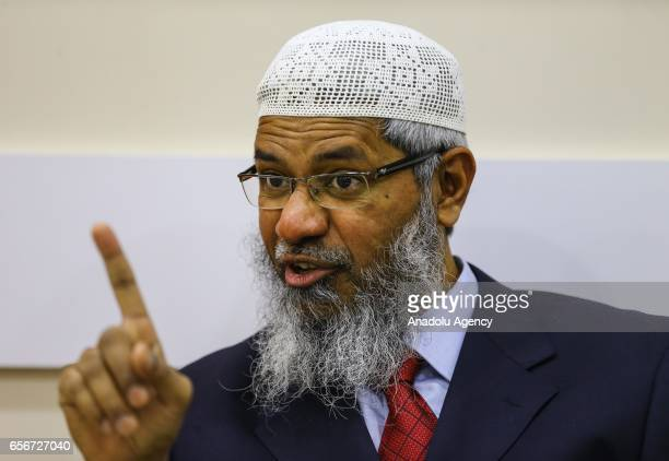President of the Islamic Research Foundation and founder of Peace TV channel Zakir Naik delivers a speech during an exclusive interview ahead of a...