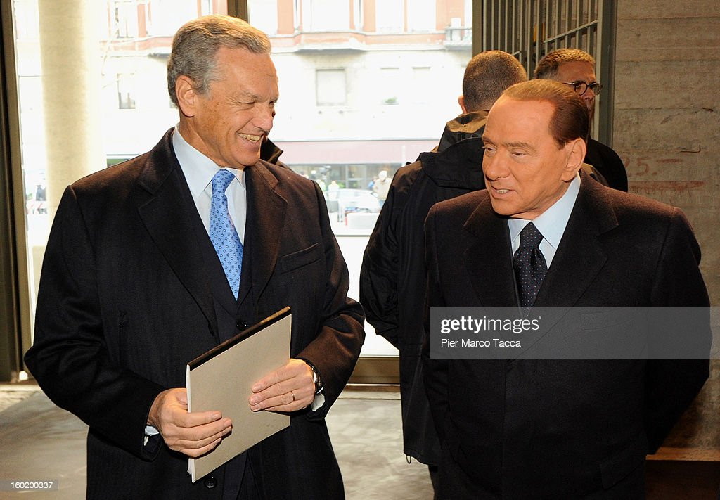 President of the Jewish community of Milan, Roberto Jarach and <a gi-track='captionPersonalityLinkClicked' href=/galleries/search?phrase=Silvio+Berlusconi&family=editorial&specificpeople=201842 ng-click='$event.stopPropagation()'>Silvio Berlusconi</a> attend the opening of 'Memoriale della Shoa' on International Holocaust Remembrance Day on January 27, 2013 in Milan, Italy. 'Memoriale della Shoa' is located at Platform 21 (Binario 21), which formed part of a secret underground rail network that transported hundreds of Jews to camps such as Auschwitz and Dachau, from1943 to 1945.