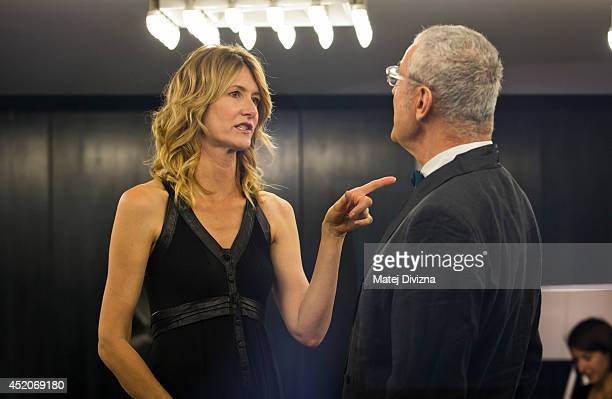 President of the Jury director Luis Minarro from Spain and actress Laura Dern talk to each other before the closing ceremony of the 49th Karlovy Vary...
