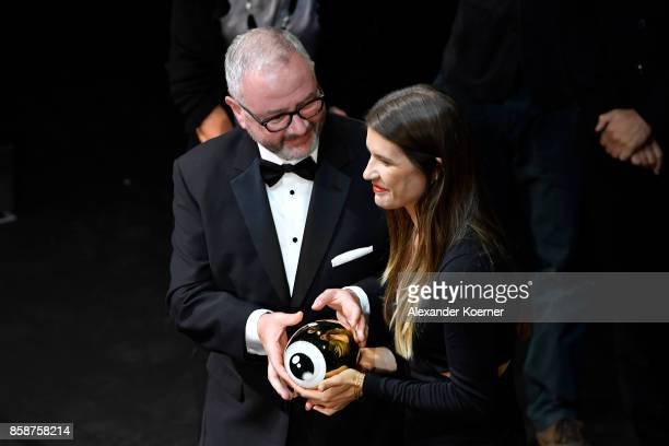 President of the jury for international documentary Simon Kilmurry hands over the award to Kaja Eggenschwiler in subsitution for the movie 'Machines'...