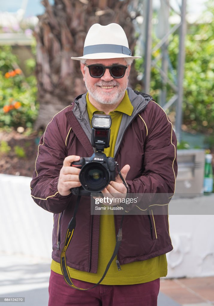 President of the jury Pedro Almodovar holds a camera as he attends the Jury photocall during the 70th annual Cannes Film Festival at Palais des Festivals on May 17, 2017 in Cannes, France.