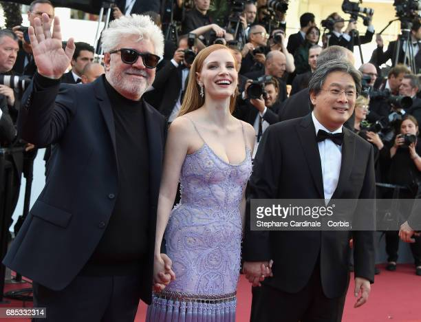 President of the jury Pedro Almodovar jurors Jessica Chastain and Park Chanwook attends the 'Okja' premiere during the 70th annual Cannes Film...