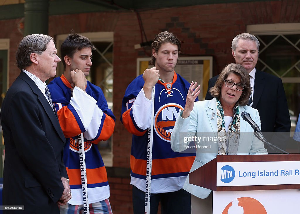 President of the Long Island Railroad, Helena E. Williams speaks to the media as (l-r) John J. Watras the Mayor of Garden City, Franz Nielsen, <a gi-track='captionPersonalityLinkClicked' href=/galleries/search?phrase=Matt+Moulson&family=editorial&specificpeople=3365493 ng-click='$event.stopPropagation()'>Matt Moulson</a> and <a gi-track='captionPersonalityLinkClicked' href=/galleries/search?phrase=Garth+Snow&family=editorial&specificpeople=203328 ng-click='$event.stopPropagation()'>Garth Snow</a> of the New York Islanders attend as the Islanders take the train to their first ever practice at the Barclays Center on September 12, 2013 in Brooklyn borough of New York City.