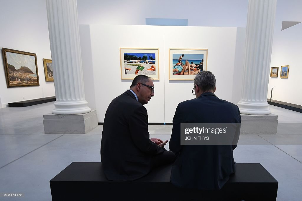 President of the Louvre museum, Jean-Luc Martinez (L) speaks with a reporter during the inauguration of the La Boverie museum, in partnership with Le Louvre, on May 4, 2016 in Liege. The new museum La Boverie was inaugurated today, with the exhibition 'En Plein Air' (In The Open Air) organised in partnership with Le Louvre museum. / AFP / JOHN