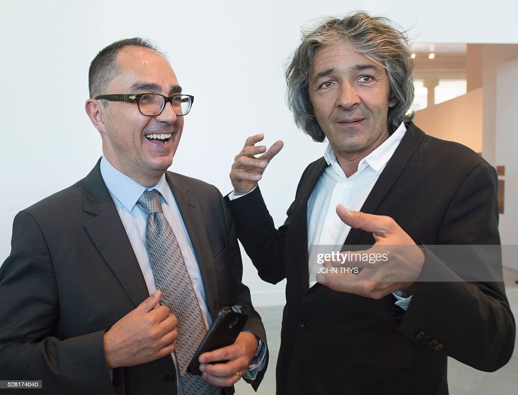President of the Louvre museum, Jean-Luc Martinez (L) talks with French Architect Rudy Ricciotti during the inauguration of the La Boverie museum, in partnership with Le Louvre, on May 4, 2016 in Liege. The new museum La Boverie was inaugurated today, with the exhibition 'En Plein Air' (In The Open Air) organised in partnership with Le Louvre museum. / AFP / JOHN
