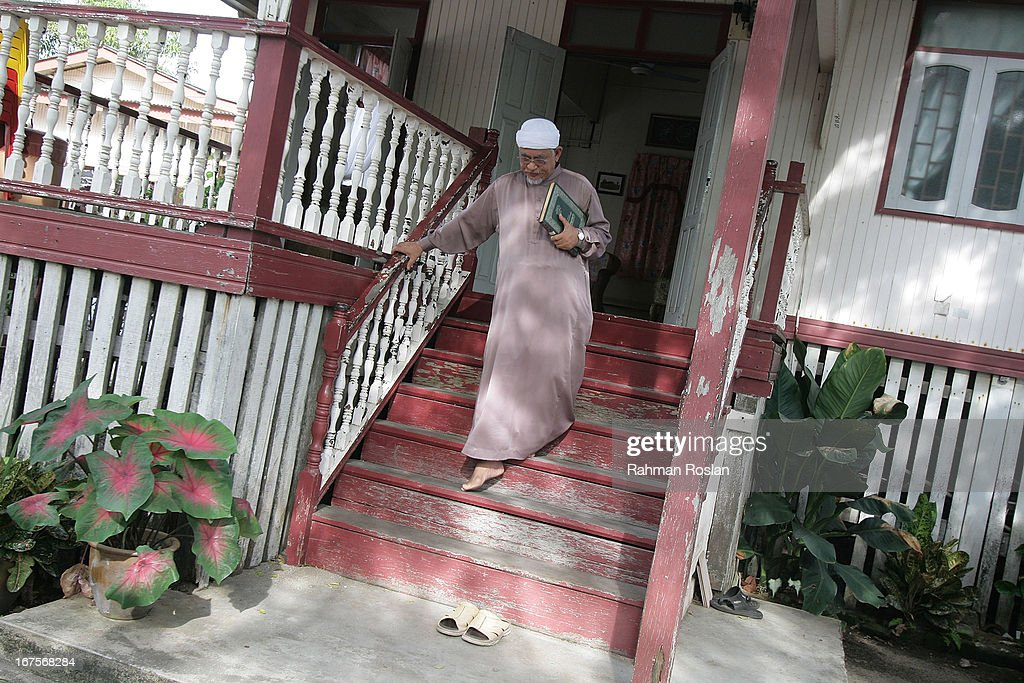 President of the Malaysian Pan Islamic Party, Abdul Hadi Awang exits his house to deliver his weekly friday sermon to his students and followers on April 26, 2013 in Rusila, Malaysia. Malaysia's 13th general election will be held on May 5.