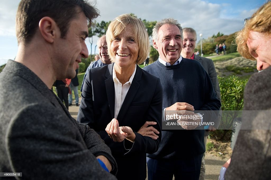 President of the MoDem centrist party <a gi-track='captionPersonalityLinkClicked' href=/galleries/search?phrase=Francois+Bayrou&family=editorial&specificpeople=551791 ng-click='$event.stopPropagation()'>Francois Bayrou</a> (R) and UDI-Modem's chief candidate for the Ile de France region and Modem vice-President <a gi-track='captionPersonalityLinkClicked' href=/galleries/search?phrase=Marielle+de+Sarnez&family=editorial&specificpeople=634936 ng-click='$event.stopPropagation()'>Marielle de Sarnez</a> (C), smile during the party's summer congress on September 25, 2015 in Guidel, western France. AFP PHOTO / JEAN-SEBASTIEN EVRARD