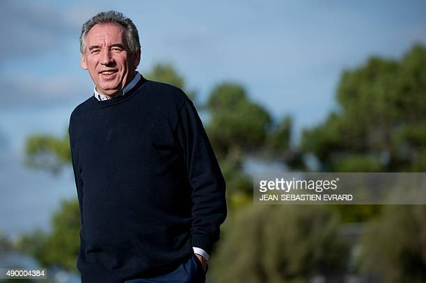 President of the MoDem centrist party Francois Bayrou smiles on September 25 2015 in Guidel western France during the opening of the party's summer...