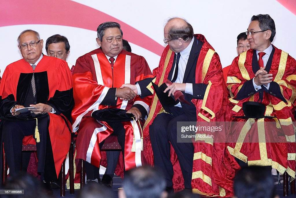 President of the Nanyang Technological University, Bertil Andersson (2 R) shakes the hand of President of Indonesia, Dr <a gi-track='captionPersonalityLinkClicked' href=/galleries/search?phrase=Susilo+Bambang+Yudhoyono&family=editorial&specificpeople=206513 ng-click='$event.stopPropagation()'>Susilo Bambang Yudhoyono</a> (2 L) during the honorary doctorate conferment ceremony on April 22, 2013 in Singapore. It is reported that President <a gi-track='captionPersonalityLinkClicked' href=/galleries/search?phrase=Susilo+Bambang+Yudhoyono&family=editorial&specificpeople=206513 ng-click='$event.stopPropagation()'>Susilo Bambang Yudhoyono</a> will hold a Leaders' Retreat with Singapore Prime Minister Lee Hsien Loong as part of the visit.