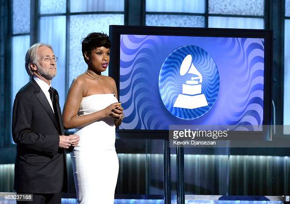 President of the National Academy of Recording Arts and Sciences Neil Portnow and recording artists Jennifer Hudson speak onstage during The 57th...