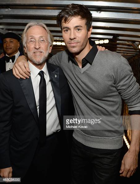 President of the National Academy of Recording Arts and Sciences Neil Portnow and singer Enrique Iglesias attend The 57th Annual GRAMMY Awards at...