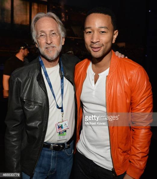 President of the National Academy of Recording Arts and Sciences Neil Portnow and singersongwriter John Legend attend 'The Night That Changed America...