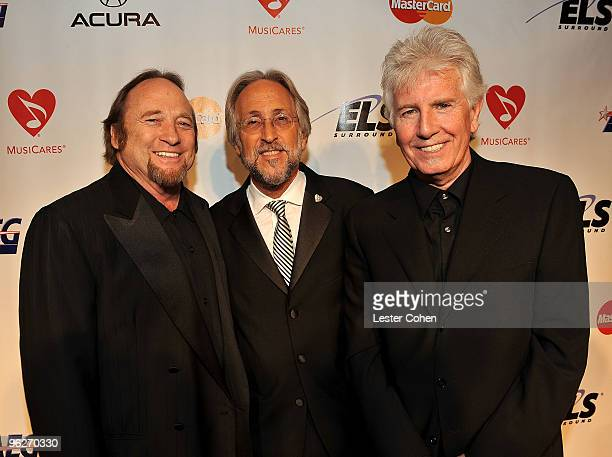President of the National Academy of Recording Arts and Sciences Neil Portnow poeses with Musicians Stephen Stills and Graham Nash of Crosby Stills...