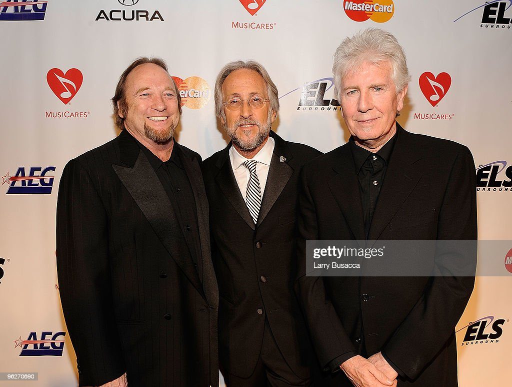 President of the National Academy of Recording Arts and Sciences Neil Portnow poses with musicians Stephen Stills and Graham Nash of Crosby Stills...