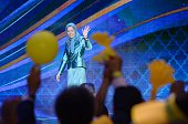 President of the National Council of Resistance of Iran Maryam Radjavi waves during the National Council of Resistance of Iran annual meeting on July...