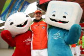 President of the National German Olympic Commitee and Chef de Mission Klaus Steinbach poses with the mascots of the Olympics Neve a snowball and Gliz...