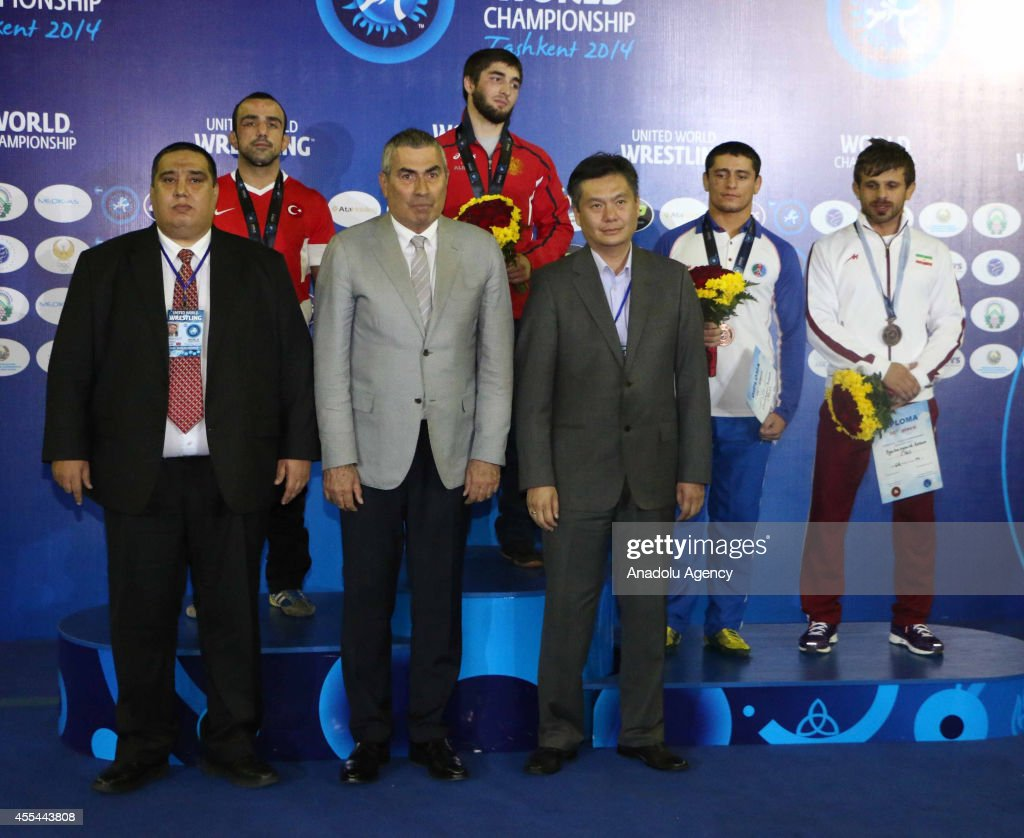 President of the National Olympic Committee of Turkey Ugur Erdener pose with medalists during the medal ceremony for the men's freestyle wrestling at...