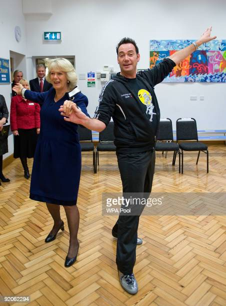 President of the National Osteoporosis Society Camilla Duchess of Cornwall and Craig Revel Horwood dance the ChaChaCha during a visit to St Clement...