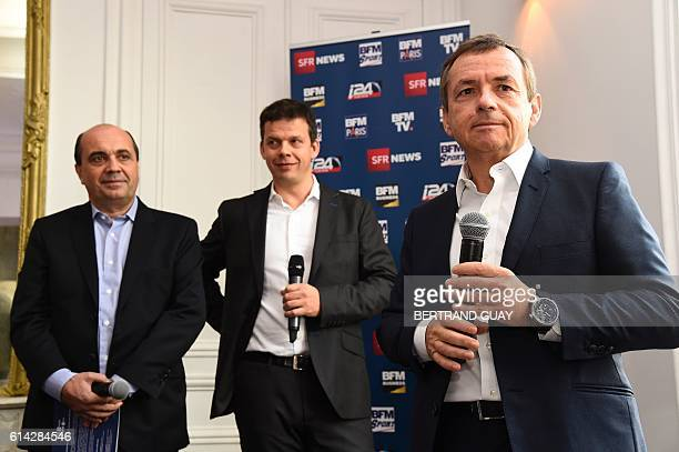 President of the NextRadioTV group and CEO of SFR group in charge of Media activities Alain Weill stands next to BFM TV's editorial director Herve...