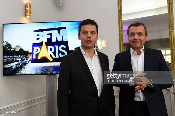 President of the NextRadioTV group and CEO of SFR group in charge of Media activities Alain Weill stands next to editorial director of BFM Paris...