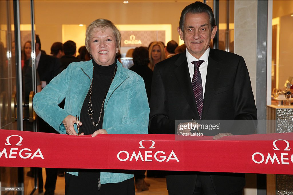 President of the North Texas Food Bank Jan Pruitt and President of Omega Stephen Urquhart cut the ribbon at the Grand Opening of the Omega Boutique at NorthPark on January 15, 2013 in Dallas, Texas.
