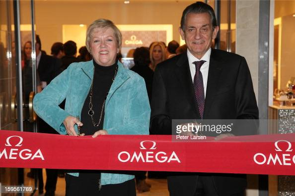 President of the North Texas Food Bank Jan Pruitt and President of Omega Stephen Urquhart cut the ribbon at the Grand Opening of the Omega Boutique...