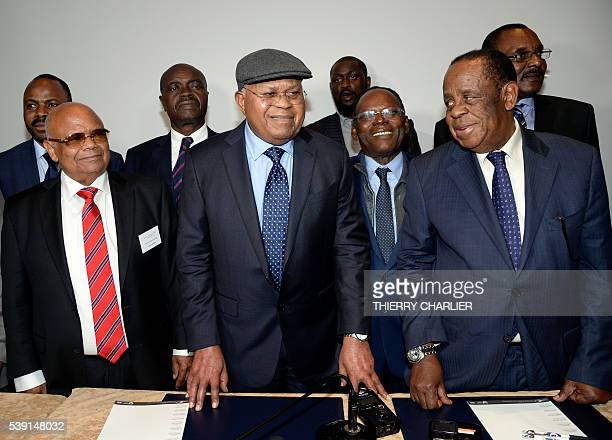 President of the opposition party Union for Democracy and Social Progress Etienne Tshisekedi stands with the brother of Moise Katumbi Raphael Katebe...