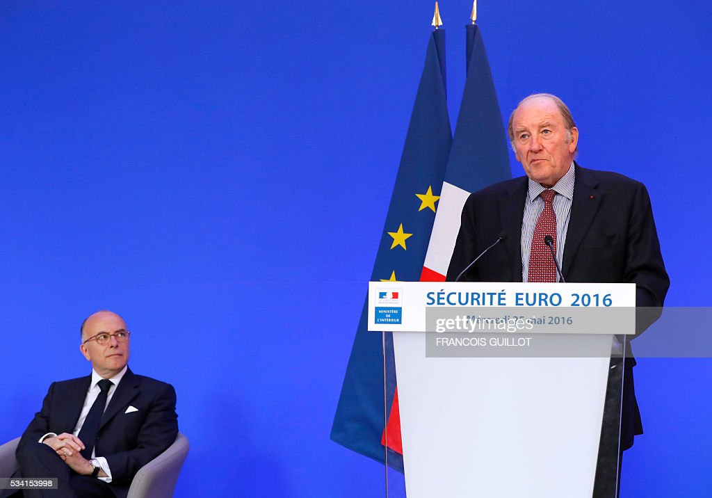 President of the organisation of the Euro 2016 Jacques Lambert delivers a speech next to French Interior minister Bernard Cazeneuve (L) during a press conference on security measures for the Euro 2016, in Paris on May 25, 2016. France said on May 25, 2016 that it will deploy more than 90,000 police and security guards for Euro 2016, vowing to do 'everything possible to avoid a terrorist attack' during the football tournament that starts next month. / AFP / FRANCOIS