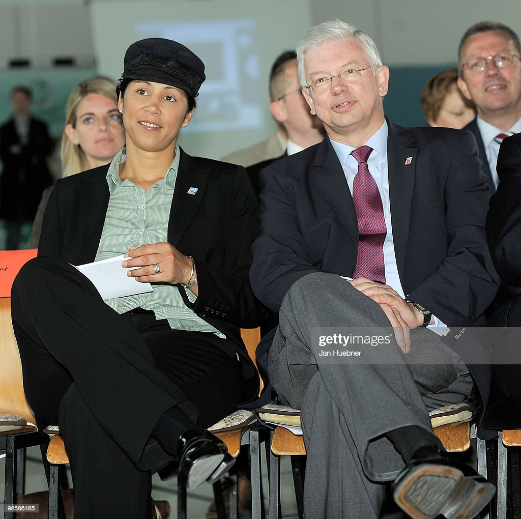 President of the Organising Committee Germany of the FIFA Women's World Cup 2011 Steffi Jones and Roland Koch, Prime minister of Hesse visit the primary school Jim Knopf Woelfersheim on April 21, 2010 in Bad Nauheim, Germany.