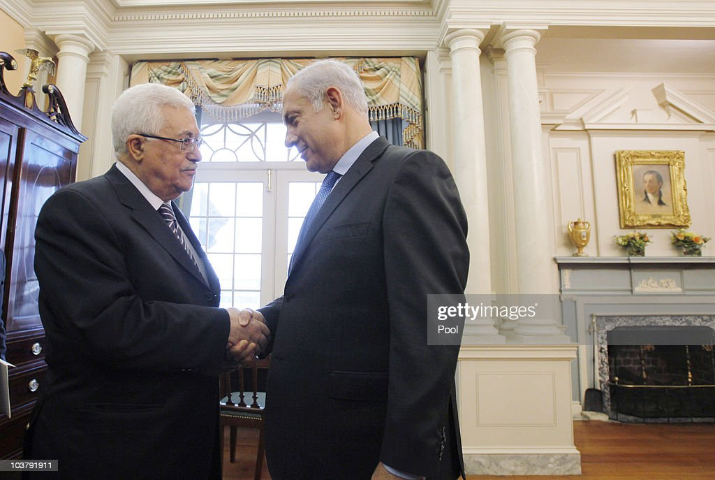 President of the Palestinian Authority <a gi-track='captionPersonalityLinkClicked' href=/galleries/search?phrase=Mahmoud+Abbas&family=editorial&specificpeople=176534 ng-click='$event.stopPropagation()'>Mahmoud Abbas</a> (L) shakes hands with Israeli Prime Minister Benjamin before holding direct peace talks at the State Department September 2, 2010 in Washington, DC. The Israeli and Palestinian leaders have started a new round of peace talks in Washington, the first one in more than 18 months.